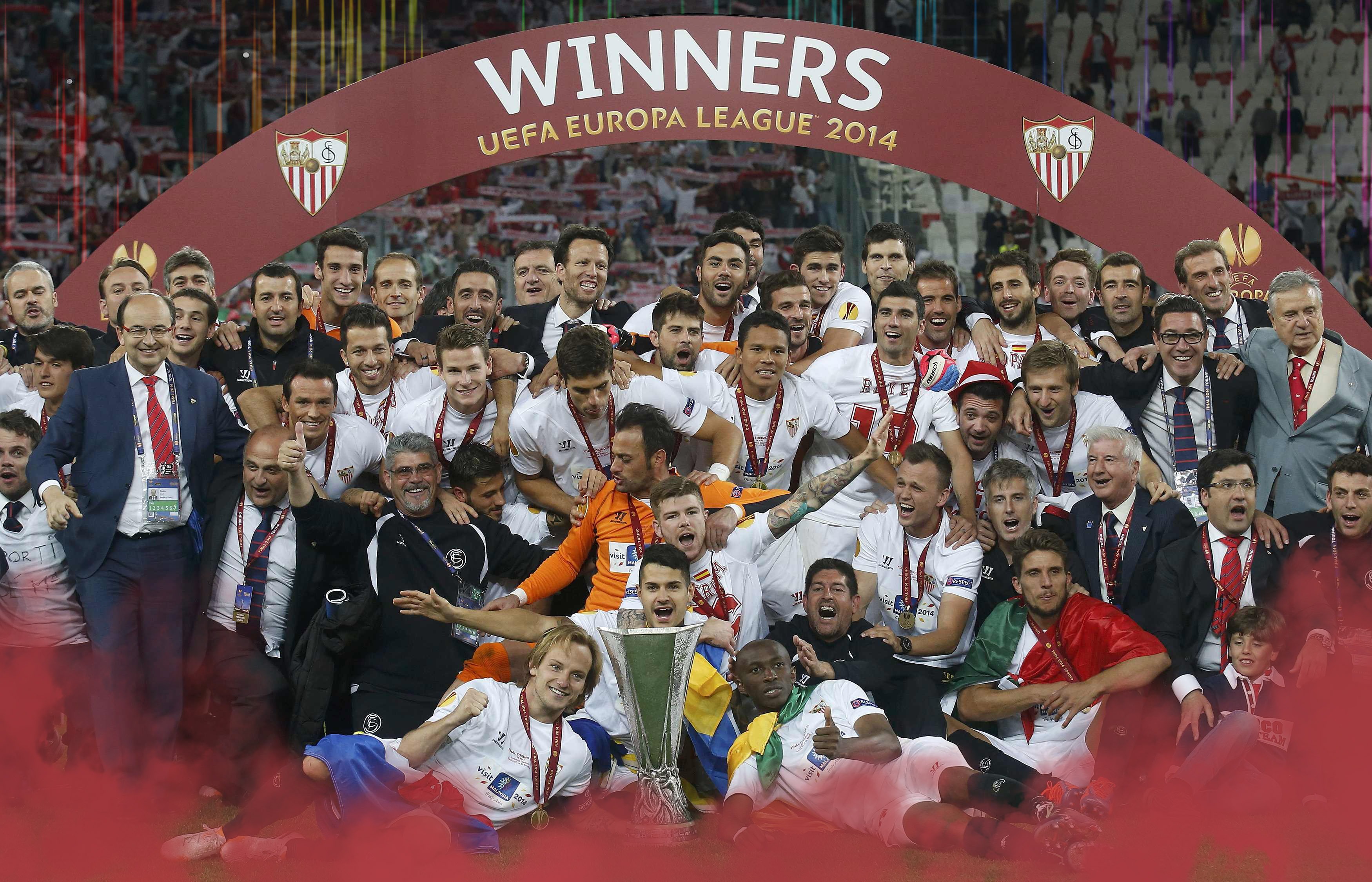 Sevilla's players pose with the trophy as they celebrate defeating Benfica in their Europa League final soccer match at the Juventus stadium in Turin